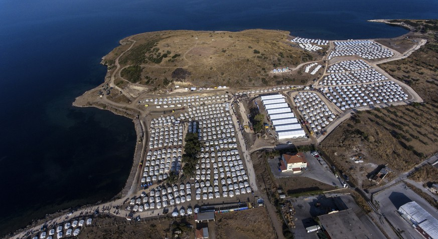 FILE - In this Thursday, Sept. 17, 2020, file photo, the new temporary refugee camp is seen from above on the northeastern island of Lesbos, Greece. The anti-torture committee of the Council of Europe, the continent's main human rights organization, on Thursday, Nov. 19, 2020 has slammed conditions under which migrants are held in some detention centers in Greece and voiced concern over persistent allegations the country conducts illegal pushbacks of migrants. (AP Photo/Panagiotis Balaskas, File)