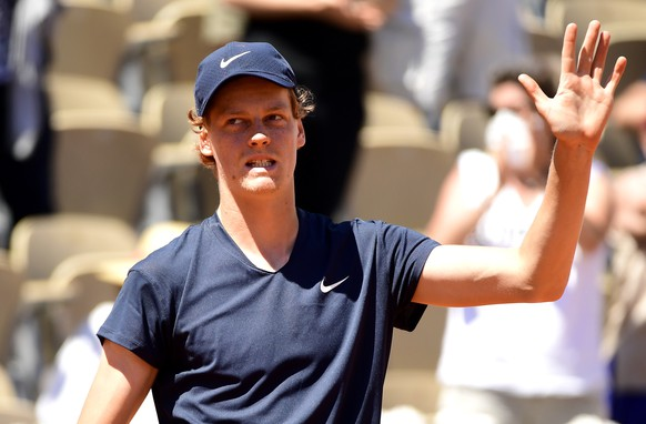 epa09238846 Jannik Sinner of Italy celebrates after defeating Pierre-Hugues Herbert of France in their first round match at the French Open tennis tournament at Roland Garros in Paris, France, 31 May 2021.  EPA/CAROLINE BLUMBERG