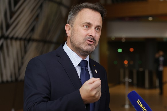 FILE - In this file photo dated Friday, June 25, 2021, Luxembourg's Prime Minister Xavier Bettel, faces the media as he arrives for an EU summit at the European Council building in Brussels.  The government of Luxembourg said Monday June 28, 2021, that Prime Minister Xavier Bettel has tested positive for COVID-19 and is in isolation for 10 days. (AP Photo/Olivier Matthys, FILE)