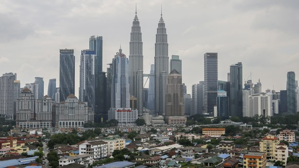 epa07867647 A view of the city skyline, shrouded by slight haze in Kuala Lumpur, Malaysia, 25 September 2019. The monsoonal winds has clear away the haze that have been covered Malaysia the past weeks with only some parts of the city still experiencing it.  EPA/AHMAD YUSNI