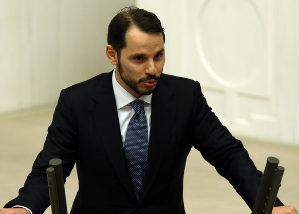Berat Albayrak, the son-in-law of Turkey's President Recep Tayyip Erdogan and a newly elected legislator, takes his oath during the Turkish parliament's first session in Ankara, Turkey, on Tuesday, June 23, 2015. The ruling Islamic-rooted Justice and Development Party (AKP) came out first in the June 7 elections but lost its parliamentary majority. (AP Photo/Burhan Ozbilici)