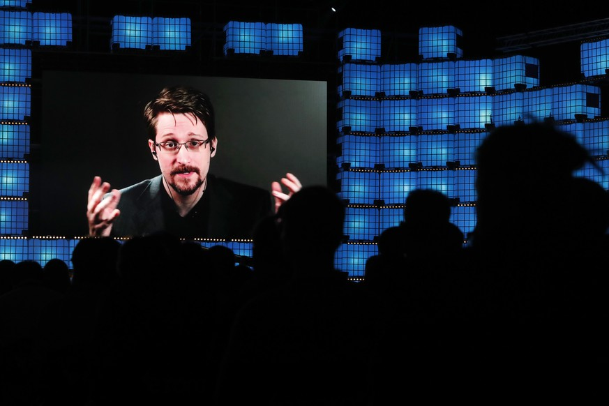 Former U.S. National Security Agency contractor Edward Snowden addresses attendees through video link at the Web Summit technology conference in Lisbon, Monday, Nov. 4, 2019. Snowden has been living in Russia to escape U.S. prosecution after leaking classified documents detailing government surveillance programs. (AP Photo/Armando Franca)