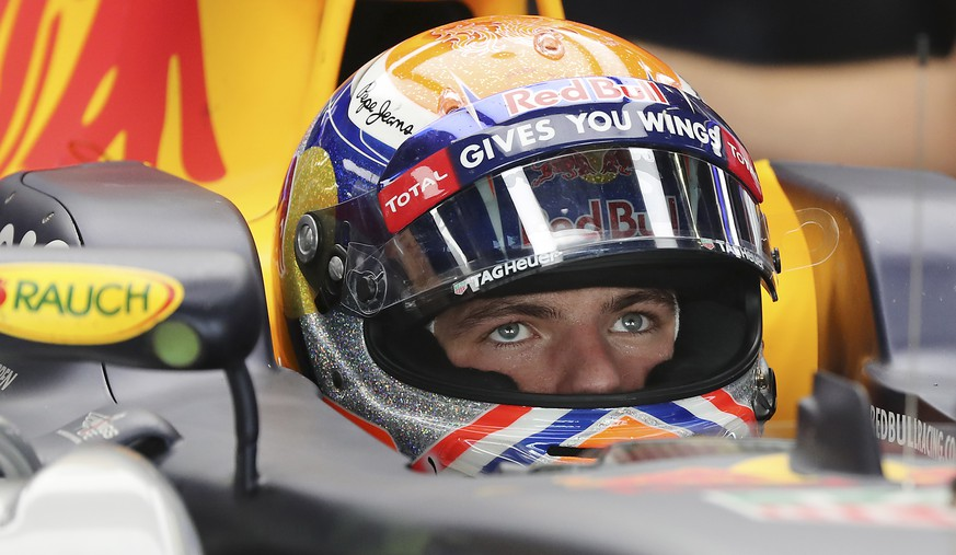 Red Bull driver Max Verstappen of the Netherlands waits in his car during the first practice session for the Japanese Formula One Grand Prix at the Suzuka International Circuit in Suzuka, central Japan, Friday, Oct. 7, 2016. (AP Photo/Eugene Hoshiko)