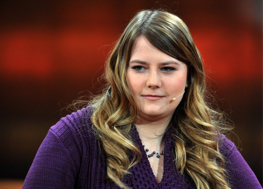 ZUM 10. JAHRESTAG DES WIEDERAUFTAUCHENS VON NATASCHA KAMPUSCH AM 23. AUGUST 2016 STELLEN WIR IHNEN FOLGENDES BILDMATERIAL ZUR VERFUEGUNG - epa03588719 Austrian Natascha Kampusch appears on the ARD television talk show 'Guenther Jauch' at the Gasometer in Berlin, Germany, 17 February 2013. The show's topic was 'Kidnapped and abused - How successful is life afterwards?'. In March 1998, Kampusch was abducted at the age of ten, and was held captive in a cellar for eight and a half years. She managed to escape from captivity on 23 August 2006.  EPA/PAUL ZINKEN