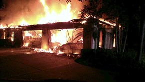 Flames engulf a house owned by former tennis pro James Blake in this handout photograph provided by the Hillsborough Sheriff's Office in Tampa, Florida May 7, 2014. Four people were found dead on Wednesday in a burning Tampa, Florida, mansion owned by Blake, police said. Blake was not inside when firefighters arrived on Wednesday morning, said Debbie Carter, a spokeswoman for the Hillsborough County Sheriff's Department. Officials said Blake was renting the home to someone else. An investigation by sheriff's investigators and the county fire marshal is under way to determine the cause of the blaze and how the four people died, officials said. REUTERS/Hillsborough County Sheriff's Office/Handout via Reuters (UNITED STATES - Tags: DISASTER SPORT TENNIS SOCIETY) AATTENTION EDITORS - THIS IMAGE WAS PROVIDED BY A THIRD PARTY. FOR EDITORIAL USE ONLY. NOT FOR SALE FOR MARKETING OR ADVERTISING CAMPAIGNS. FOR EDITORIAL USE ONLY. NOT FOR SALE FOR MARKETING OR ADVERTISING CAMPAIGNS. THIS PICTURE IS DISTRIBUTED EXACTLY AS RECEIVED BY REUTERS, AS A SERVICE TO CLIENTS