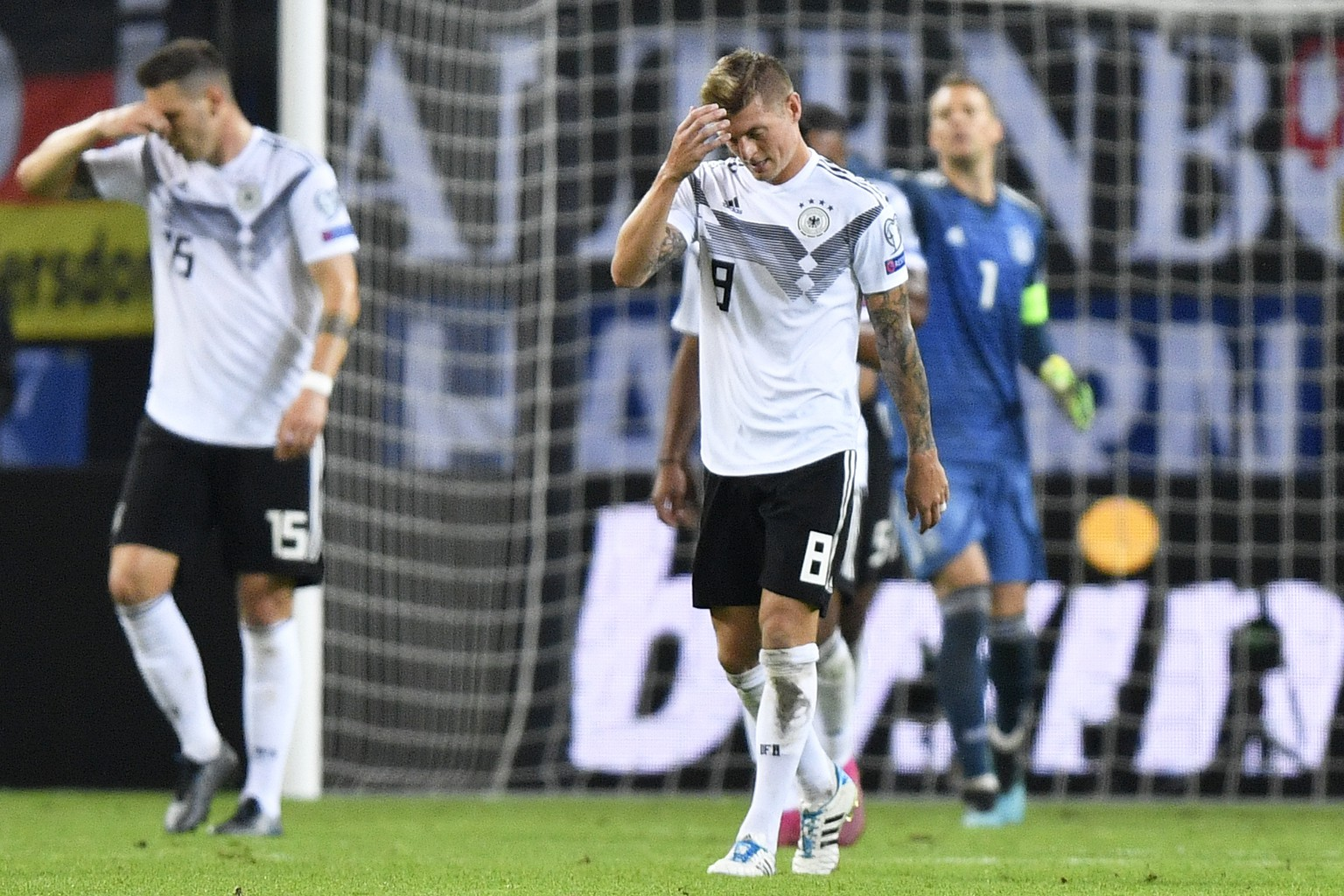 Germany's Toni Kroos reacts after the Netherland's second goal during the Euro 2020 group C qualifying soccer match between Germany and the Netherlands at the Volksparkstadion in Hamburg, Germany, Friday, Sept. 6, 2019. (AP Photo/Martin Meissner)