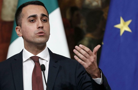 Italian Deputy Premier and Labour and Industry Minister, Luigi Di Maio, speaks at a press conference following a Cabinet meeting at Chigi Palace's premier office in Rome, Thursday, Jan. 17, 2019. The government unveiled details of how it will fulfill two core campaign promises: providing a basic income to needy Italians looking for work, and reforming unpopular pension regulations.  (Riccardo Antimiani/ANSA via AP)