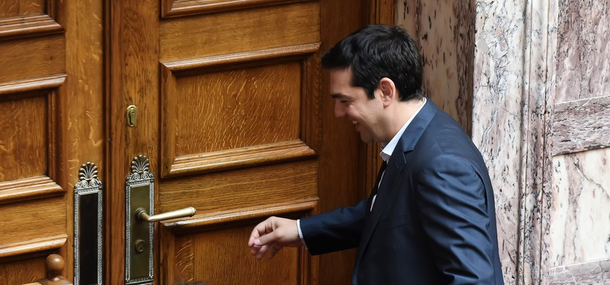 Greece's Prime Minister Alexis Tsipras smiles as he leaves from the Greek Parliament in Athens, Thursday, July 9, 2015. Greece's government was racing Thursday to finalize a plan of reforms for its third bailout, hoping this time the proposal will meet with approval from its European partners and stave off a potentially catastrophic exit from Europe's joint currency, the euro, within days. (Nikos Chalkiopoulos/InTime News via AP)  GREECE OUT