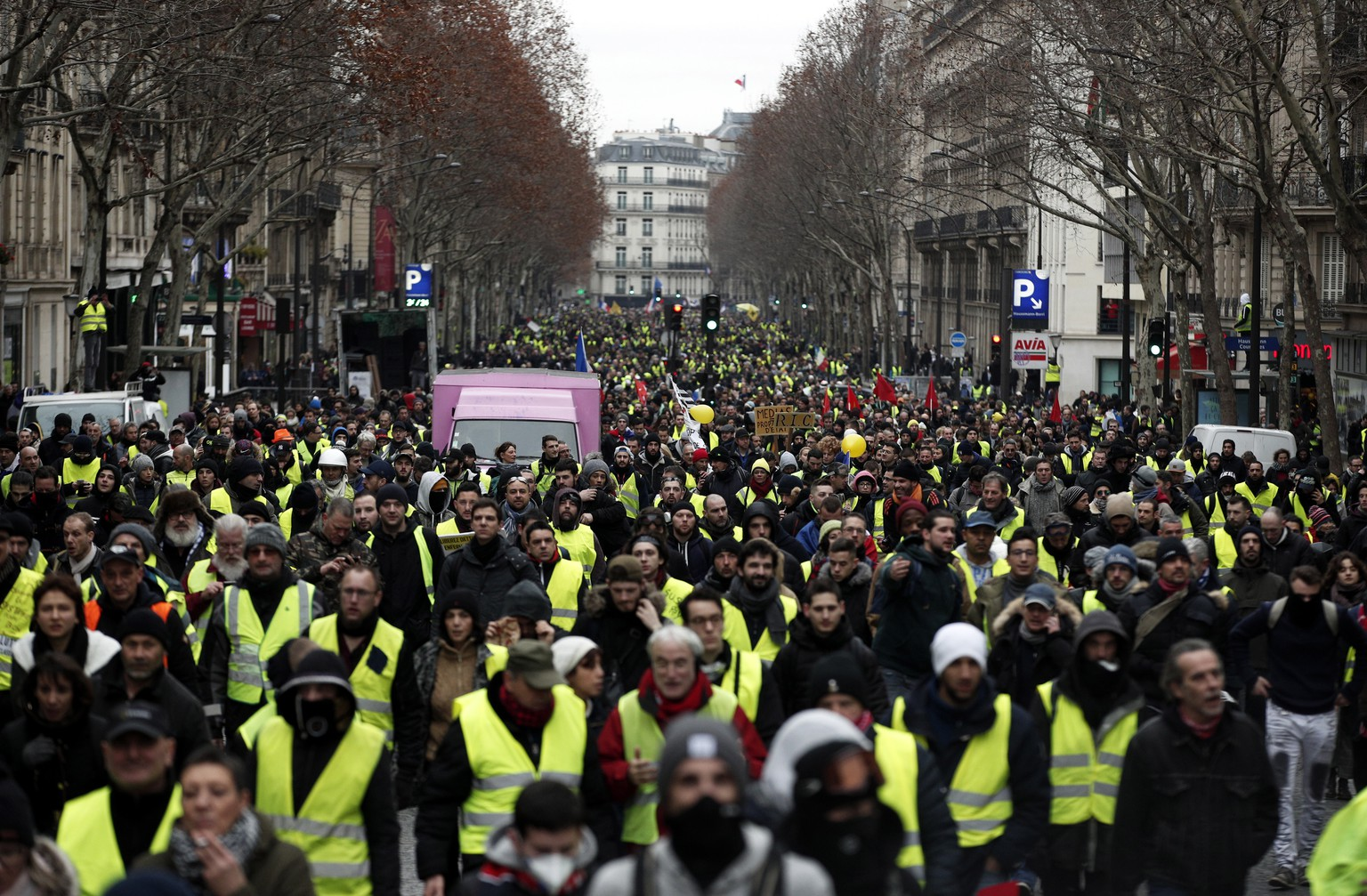 epa07277484 Protesters from the 'Gilets Jaunes' (Yellow Vests) movement take part in the 'Act IX' demonstration (the 9th consecutive national protest on a Saturday) in Paris, France, 12 January 2019. The so-called 'gilets jaunes' (yellow vests) is a grassroots protest movement with supporters from a wide span of the political spectrum, that originally started with protest across the nation in late 2018 against high fuel prices. The movement in the meantime also protests the French government's tax reforms, the increasing costs of living and some even call for the resignation of French President Emmanuel Macron.  EPA/YOAN VALAT