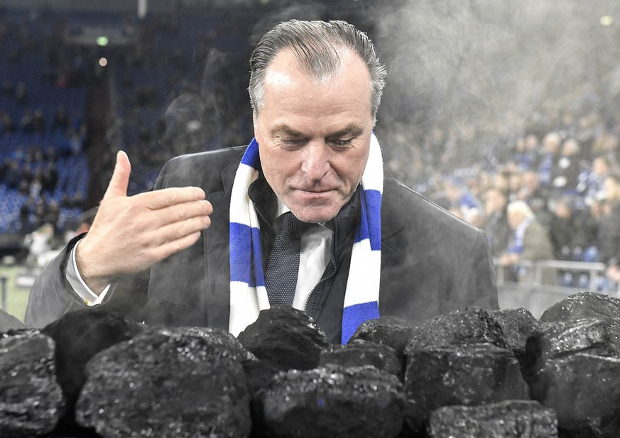 FILE-In this Dec. 19, 2018 file photo Schalke boss Clemens Toennies smells steaming coal on a trolley beside the pitch prior the Bundesliga soccer match between FC Schalke 04 and Bayer Leverkusen in Gelsenkirchen, Germany. Schalke chairman Clemens Tönnies has resisted calls to resign and will instead step down for three months over comments he made last week that were widely condemned as racist. (AP Photo/Martin Meissner)