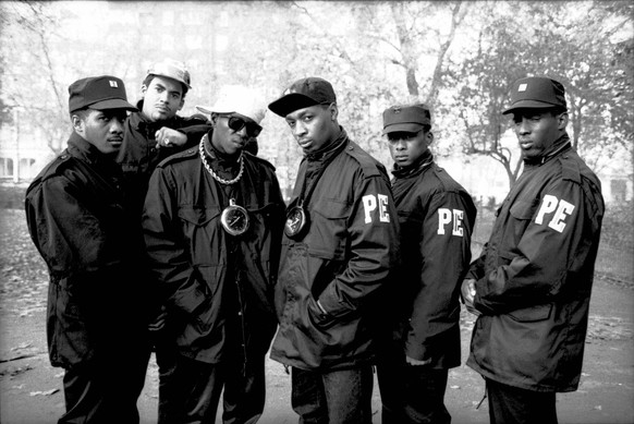 UNITED KINGDOM - FEBRUARY 11:  HYDE PARK  Photo of Flavor FLAV and Chuck D and PUBLIC ENEMY, B&W Posed  (Photo by David Corio/Redferns)