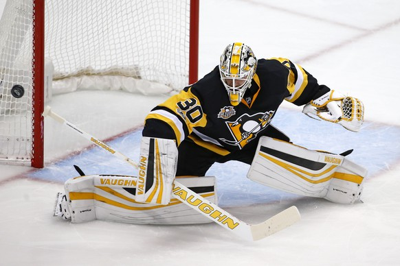 Pittsburgh Penguins goalie Matt Murray blocks a shot in the first period of an NHL hockey game against the Boston Bruins in Pittsburgh, Sunday, Jan. 22, 2017. (AP Photo/Gene J. Puskar)