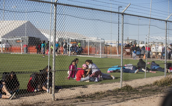 In this Nov. 25, 2018 photo provided by Ivan Pierre Aguirre, migrant teens held inside the Tornillo detention camp look at protestors waving at them outside the fences surrounding the facility in Tornillo, Texas. The Trump administration announced in June 2018 that it would open the temporary shelter for up to 360 migrant children in this isolated corner of the Texas desert. Less than six months later, the facility has expanded into a detention camp holding thousands of teenagers - and it shows every sign of becoming more permanent. (Ivan Pierre Aguirre via AP)