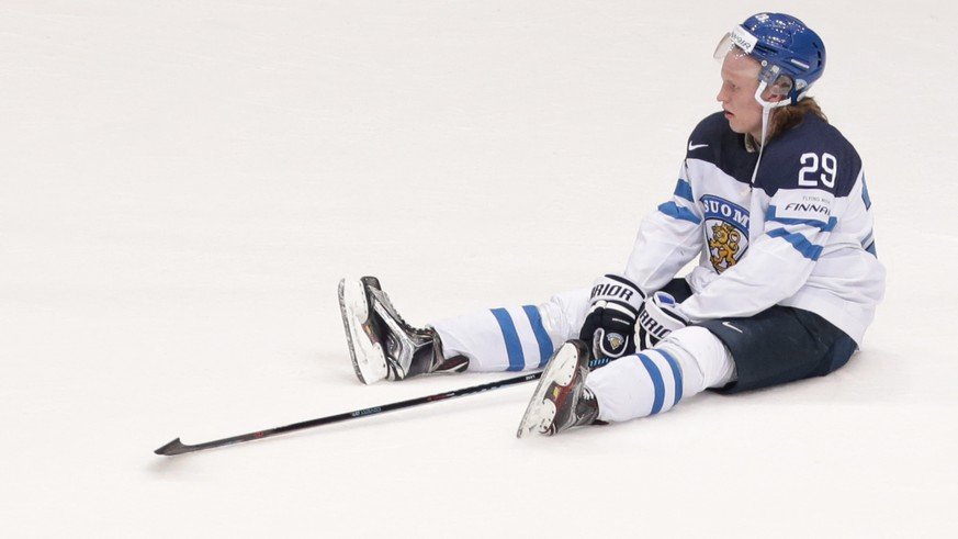 Finland's Patrik Laine reacts after team's loss at the Ice Hockey World Championships final match between Finland and Canada, in Moscow, Russia, on Sunday, May 22, 2016. (AP Photo/Ivan Sekretarev)