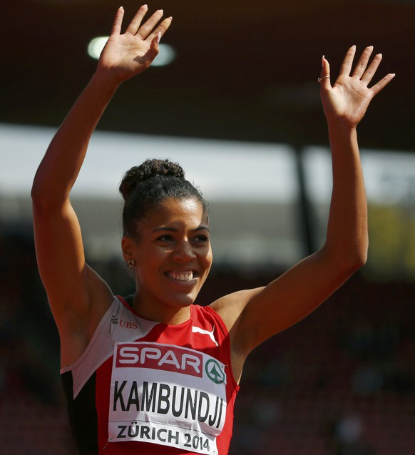 Mujinga Kambundji of Switzerland smiles after her women's 200 metres heat during the European Athletics Championships at the Letzigrund Stadium in Zurich August 14, 2014.                REUTERS/Arnd Wiegmann (SWITZERLAND  - Tags: SPORT ATHLETICS)