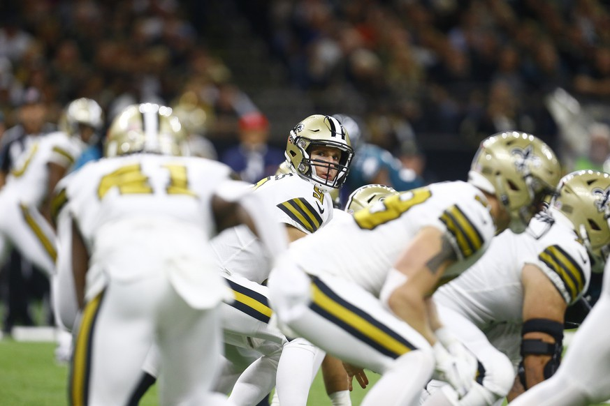 New Orleans Saints quarterback Drew Brees (9) crouches under center in the first half of an NFL football game against the Philadelphia Eagles in New Orleans, Sunday, Nov. 18, 2018. (AP Photo/Butch Dill)
