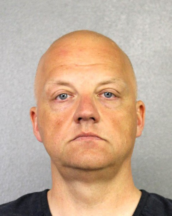 epa06124577 A handout photo made available by Broward County Sheriff's Office on 04 August 2017 shows a booking photo of Volkswagen (VW) exeucive Oliver Schmidt in Fort Lauderdale, Florida, USA, 09 January 2017 (issued 04 August 2017). VW executive Oliver Schmidt on 04 August 2017 pleaded guilty at district court in Detroit, USA in connection with the Volkswagen diesel emissions scandal. Schmidt admitted to conspiring to mislead US regulators and violating clean air laws.  EPA/Broward County Sheriff's Office / HANDOUT  HANDOUT EDITORIAL USE ONLY/NO SALES