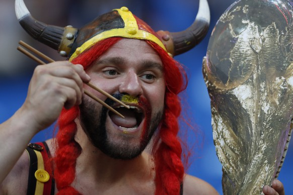 A Belgium fan gestures prior for the start of the match of the round of 16 match between Belgium and Japan at the 2018 soccer World Cup in the Rostov Arena, in Rostov-on-Don, Russia, Monday, July 2, 2018. (AP Photo/Rebecca Blackwell)