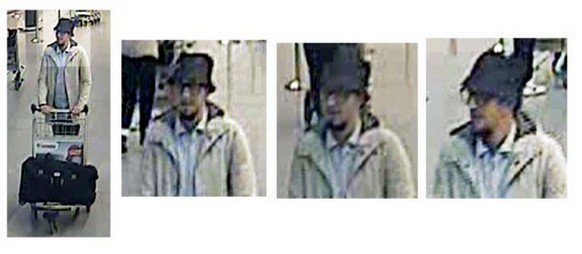 epa05226546 A handout image provided by Belgian Federal Police shows a CCTV grab of one of the three suspects in the Zaventem airport attack in Brussels, Belgium, 22 March 2016. A surveillance camera at Zaventem airport in Brussels captured footage of the alleged perpetrators of the explosions that took place earlier the day. It reveals two men dressed in black and both wearing one glove on their left hand, which according to La Libre Belgique could have served to conceal the detonators. The third (pictured), dressed in a white jacket and wearing a black hat, is being 'actively pursued' in the meantime, according to Belgian newspapers.  EPA/BELGIAN FEDERAL POLICE / HANDOUT BEST QUALITY AVAILABLE HANDOUT EDITORIAL USE ONLY/NO SALES