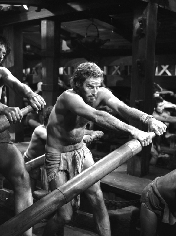 This image provided by Cinecitta studio's in Rome shows Charlton Heston in character portraying a galley slave in scene from the movie