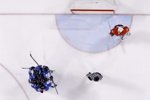 Finland players, top left, celebrate a goal by Michelle Karvinen (33) during the second period of the preliminary round of the men's hockey game against the Olympic team from Russia at the 2018 Winter Olympics in Gangneung, South Korea, Thursday, Feb. 15, 2018. Finland won 5-1. (AP Photo/Julio Cortez)