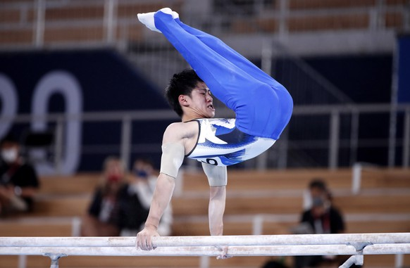 epa09374055 Daiki Hashimoto of Japan competes on the Parallel Bars in the Men's All-Around Final during the Artistic Gymnastics events of the Tokyo 2020 Olympic Games at the Ariake Gymnastics Centre in Tokyo, Japan, 28 July 2021.  EPA/TATYANA ZENKOVICH