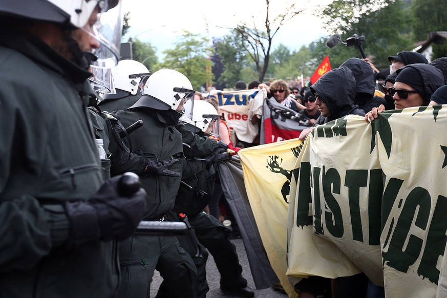 GARMISCH-PARTENKIRCHEN, GERMANY - JUNE 06:  Police officers scuffle with anti-G7 protesters on June 6, 2015 in Garmisch-Partenkirchen, Germany. G7 leaders will meet at nearby Schloss Elmau on June 7-8 and protesters are holding a variety of gatherings and demonstrations to voice their opposition.  (Photo by Carl Court/Getty Images)
