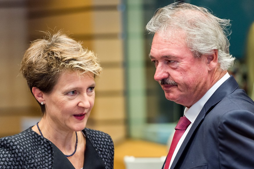 Luxembourg's Minister of Foreign and European Affairs Jean Asselborn, right, talks with Swiss Justice Minister Simonetta Sommaruga at the start of a meeting of EU justice and interior ministers at the EU Council building in Brussels on Tuesday, Sept. 22, 2015. EU interior ministers aim to agree on a plan to share 120,000 refugees in countries worst hit by the influx among their other EU partners. (AP Photo/Geert Vanden Wijngaert)