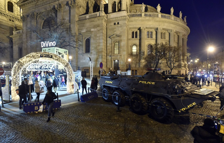 epa06395851 An armoured vehicle of the Counter Terrorism Centre (TEK) is on patrol in front of the entrance of the Christmas market titled 'Advent Feast at the Basilica' next to the St. Stephen Basilica downtown of Budapest, Hungary, 17 December 2017, on the third Sunday of Advent. The 'Advent Feast at the Basilica' Christmas market won the fourth place in the audience polling organized by the independent European Best Destinations travel portal, which select the best Christmas markets in Europe.  EPA/Zoltan Mathe HUNGARY OUT