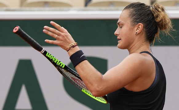 Belarus's Aryna Sabalenka reacts after losing a point against Russia's Anastasia Pavlyuchenkova during their third round match on day 6, of the French Open tennis tournament at Roland Garros in Paris, France, Friday, June 4, 2021. (AP Photo/Michel Euler)
