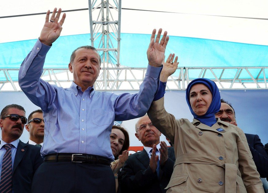 Turkey's President Recep Tayyip Erdogan, left and his wife Emine Erdogan salute supporters as he addresses an election rally ahead of the upcoming June 7, 2015 general elections in Agri, Turkey, Saturday, June 6, 2015. The overarching drama of the election has been whether Erdogan's Justice and Development Party, or AKP, will win a strong enough majority to change the constitution and put Erdogan at the unquestioned pinnacle of Turkish politics in a new presidential system. (AP Photo)