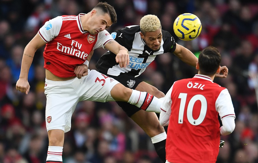 epa08222592 Arsenal's Granit Xhaka (L) vies for the ball with Newcastle United's Joelinton (R)  during an English Premier League soccer match at the Emirates Stadium in London, Britain, 16 February 2020.  EPA/ANDY RAIN EDITORIAL USE ONLY. No use with unauthorized audio, video, data, fixture lists, club/league logos or 'live' services. Online in-match use limited to 120 images, no video emulation. No use in betting, games or single club/league/player publications