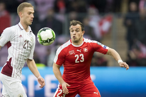 Latvia's Midfielder Gļebs Kļuskins, left, fights for the ball with Swiss forward Xherdan Shaqiri, right, during the 2018 Fifa World Cup Russia group B qualification soccer match between Switzerland and Latvia, at the stade de Geneve stadium, in Geneva, Switzerland, Saturday, March 25, 2017. (KEYSTONE/Jean-Christophe Bott)