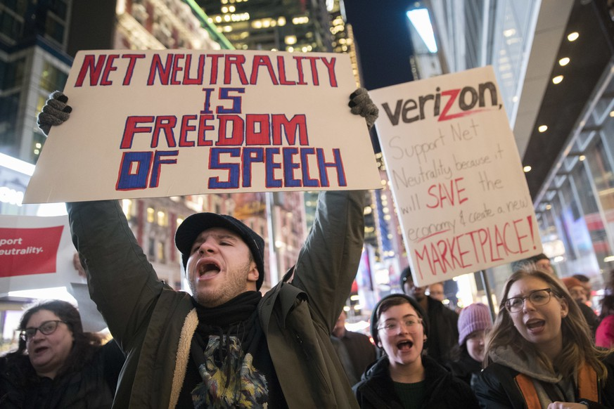 "FILE - In this Thursday, Dec. 7, 2017, file photo, demonstrators rally in support of net neutrality outside a Verizon store in New York. The Federal Communications Commission is voting Thursday, Dec. 14 to undo Obama-era ""net neutrality"" rules that guaranteed equal access to the internet. The industry promises that the internet experience isn't going to change, but the issue has struck a nerve. Protests have erupted online and in the streets as everyday Americans worry that companies like Comcast, Verizon and AT&T will be able to control what they see and do online. (AP Photo/Mary Altaffer, File)"