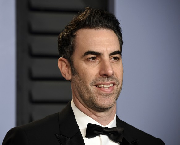 FILE - In this March 4, 2018 file photo, Sacha Baron Cohen arrives at the Vanity Fair Oscar Party in Beverly Hills, Calif. Cohen stars in the new Showtime series