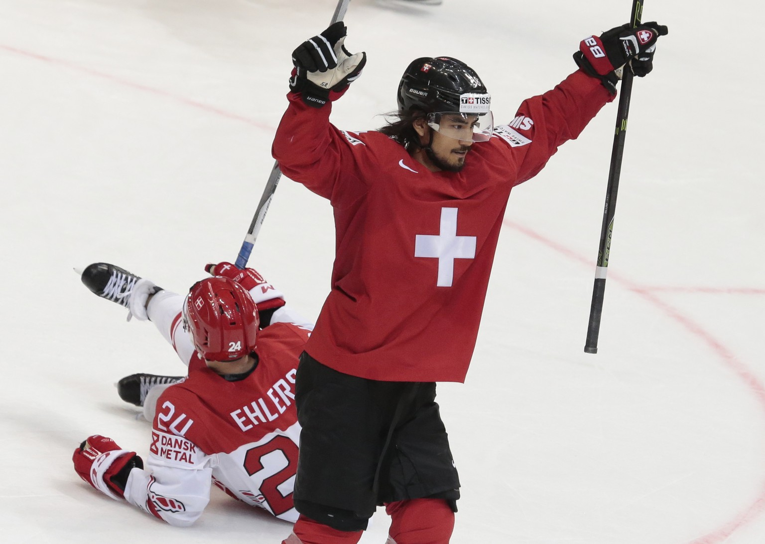 Switzerland's Eric Blum reacts after scoring victory goal during the overtime action of the Ice Hockey World Championships Group A match between Switzerland and Denmark, in Moscow, Russia, on Tuesday, May 10, 2016. (AP Photo/Ivan Sekretarev)