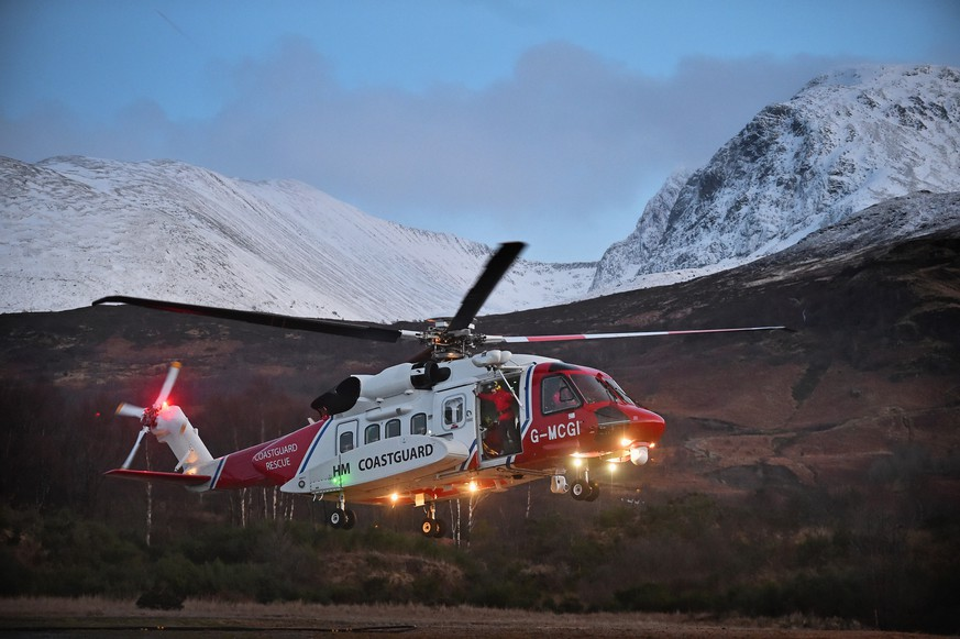 FORT WILLIAM, SCOTLAND - FEBRUARY 17:  Rescue teams and a Coastguard helicopter are deployed to the scene of an Avalanche at Creag Meagaidh on February 17, 2016 in Fort William,Scotland. The rescuers had been searching for missing climbers Rachel Slater, 24, and Tim Newton, 27 from Bradford, had been climbing on Ben Nevis over the weekend but were reported missing on Monday.  (Photo by Jeff J Mitchell/Getty Images)