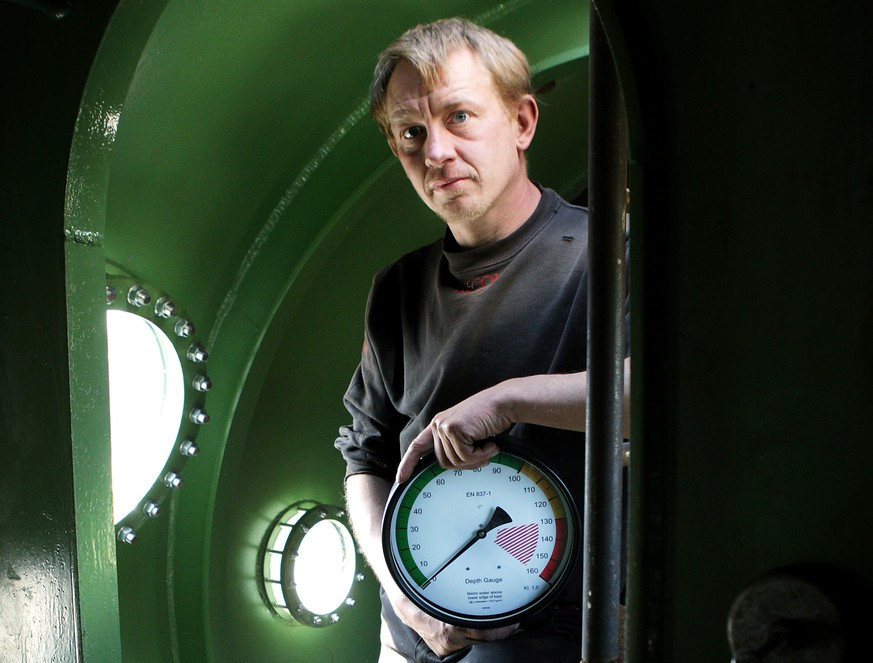FILE - In this April 30, 2008 file photo, submarine owner Peter Madsen stands inside the vessel. One of the most talked-about and macabre court cases in recent Danish history is set to conclude Wednesday, April 25, 2018 when the verdict is handed down on whether Peter Madsen tortured and murdered a Swedish journalist during a private submarine trip. (Niels Hougaard /Ritzau via AP, File)