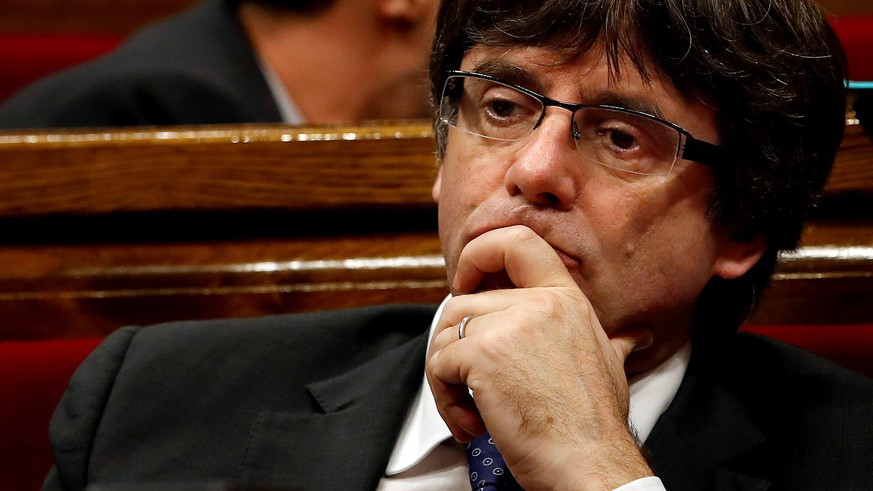 epa06293125 Catalan regional Government President, Carles Puigdemont, during a plenary session of the Catalan Assembly to approve the declaration of a uniteral independence, at the Parlament in Barcelona, northeastern Spain, 27 October 2017. As consequence of this result, Catalan Assembly urges the Catalan government to begin a constituent process to draft and approve the Constitution of the new republic.  EPA/Quique Garcia