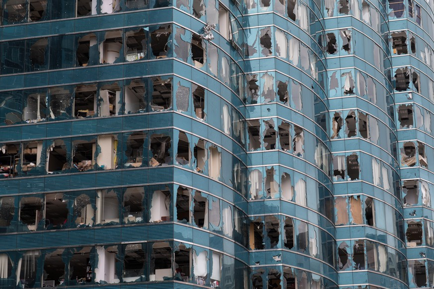 epa07026886 Office towers damaged by Typhoon Mangkhut in Hung Hom district, Hong Kong, China, 17 September 2018. Typhoon Mangkhut was one of the most severe storms to hit Hong Kong in recent decades. According to the Hong Kong Observatory, the super typhoon is officially Hong Kong's most intense storm since records began as it hit the autonomous territory with sustained winds reaching up to 250km/h.  EPA/JEROME FAVRE