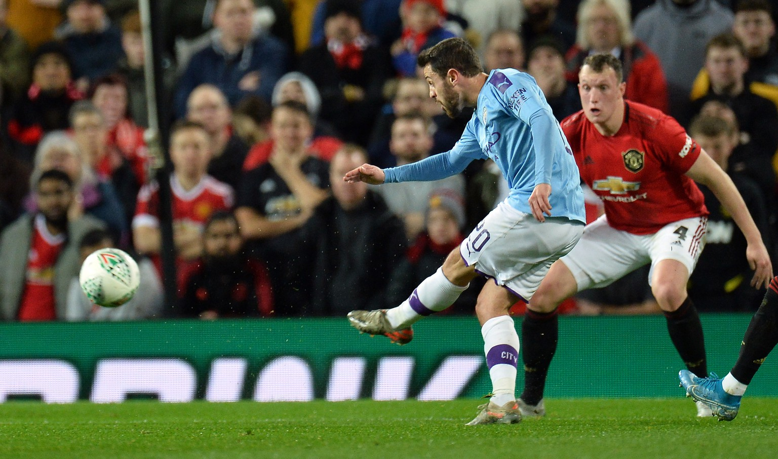 epa08110945 Manchester City's Bernardo Silva (L) scores during the Carabao Cup first round semi-final soccer match between Manchester United and Manchester City held at Old Trafford in Manchester, Britain, 07 January 2020.  EPA/PETER POWELL EDITORIAL USE ONLY.  No use with unauthorized audio, video, data, fixture lists, club/league logos or 'live' services. Online in-match use limited to 120 images, no video emulation. No use in betting, games or single club/league/player publications.