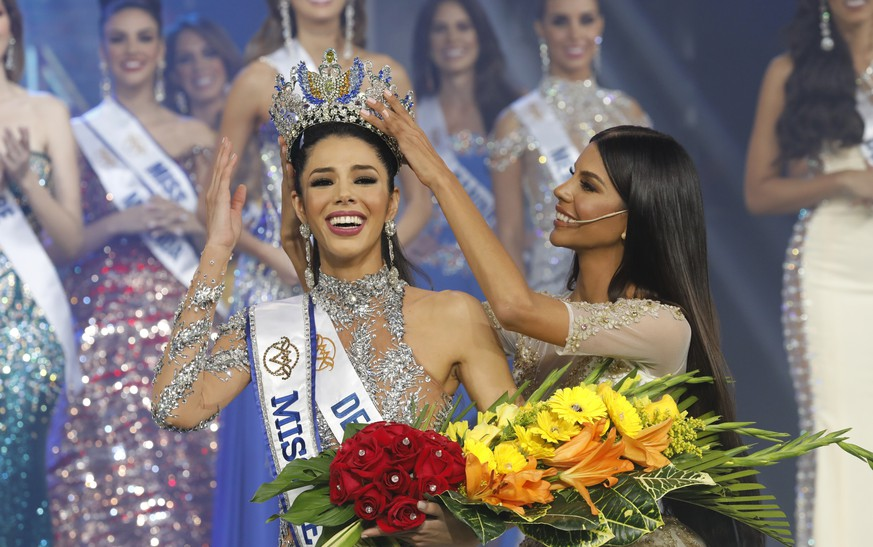 Thalia Olvino, representing Delta Amacuro state, is crowned Miss Venezuela at the end of the beauty pageant in Caracas, Venezuela, Thursday, Aug. 1, 2019. (AP Photo/Ariana Cubillos)