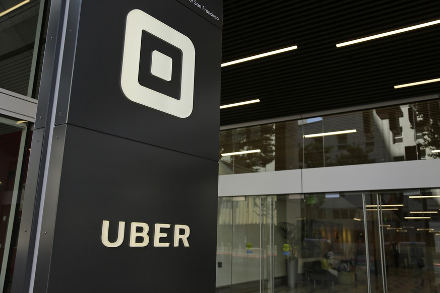 FILE - This Wednesday, June 21, 2017, file photo shows the building that houses the headquarters of Uber, in San Francisco. In a move announced Monday, Nov. 6, 2017, Uber is pledging $5 million over the next five years to seven organizations that work to prevent sexual assaults, a move aimed at helping the ride-hailing service combat its own problems as well as society as a whole. (AP Photo/Eric Risberg, File)