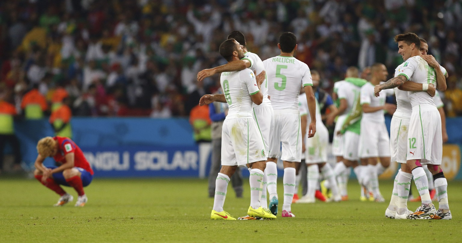 Algerian players celebrate after their 4-2 victory over South Korea during the group H World Cup soccer match between South Korea and Algeria at the Estadio Beira-Rio in Porto Alegre, Brazil, Sunday, June 22, 2014. (AP Photo/Jon Super)