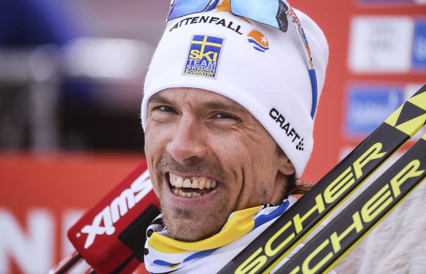 epa04636612 Sweden's Johan Olsson reacts after crossing the finish line during the men's 15km Individual Free cross country skiing race at the Nordic Skiing World Championships in Falun, Sweden, 25 February 2015.  EPA/FREDRIK SANDBERG SWEDEN OUT