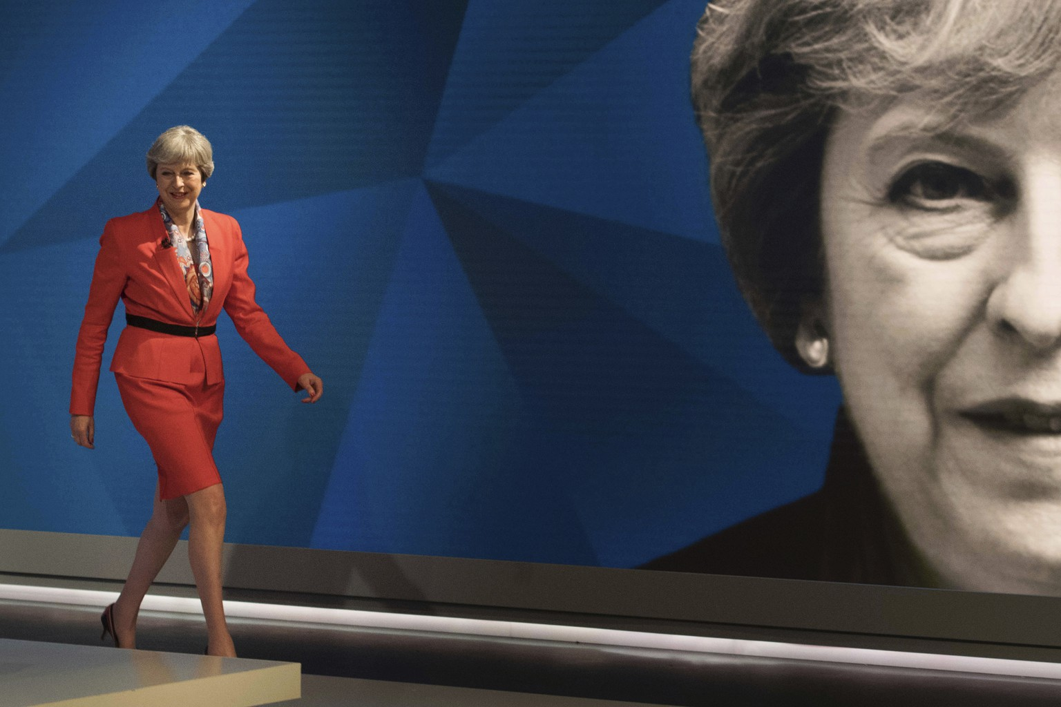 British Prime Minister Theresa May walks out to take part in a general election broadcast, in London, Monday May 29, 2017. Prime Minister Theresa May and Labour Party leader Jeremy Corbyn will face a live studio audience and a tough TV interviewer as the general election campaign moves to the airwaves. (Stefan Rousseau/ Pool Photo via AP)