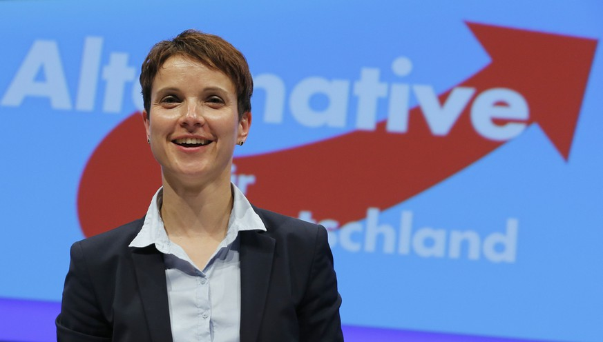 Alternative fuer Deutschland (AfD)  Frauke Petry smiles in front of the party's logo at the party congress in Essen, western Germany, July 4, 2015.   REUTERS/Wolfgang Rattay