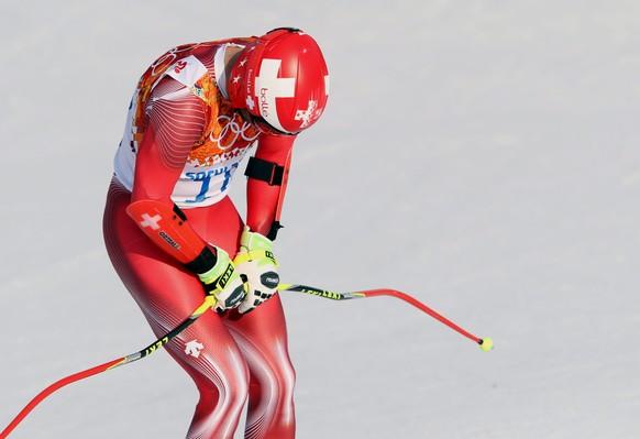 epa04080508 Didier Defago of Switzerland in action during the Men's Super G race at the Rosa Khutor Alpine Center at the Sochi 2014 Olympic Games, Krasnaya Polyana, Russia, 16 February 2014.  EPA/ANTONIO BAT