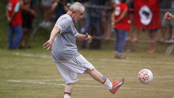 Brazil's former president Luiz Inacio Lula da Silva strikes the ball during a friendly soccer match with members of the Landless Workers Movement in Guararema, Brazil, Sunday, Dec. 22, 2019. (AP Photo/Nelson Antoine)