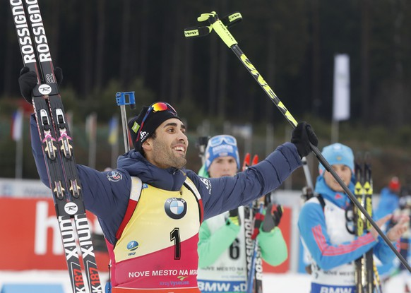 France's Martin Fourcade celebrates winning the men's Biathlon World Cup 15 km mass start event in Nove Mesto na Morave, Czech Republic, Sunday, Dec. 18, 2016. (AP Photo/Petr David Josek)